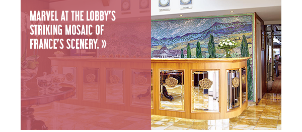 Marvel at the lobby's striking mosaic of provence's scenery.